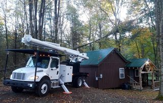 bucket truck next to cabin